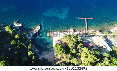 Aerial drone bird's eye view photo of iconic historical small island of Vidos a few nautical miles away from Corfu old town, Corfu island, Ionian, Greece #1201132492
