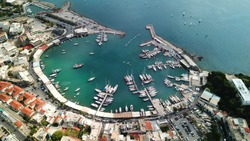 Aerial drone bird's eye view photo of iconic round shaped picturesque port of Mikrolimano with sail boats and yachts docked and beautiful colours, Pireas port, Attica, Greece