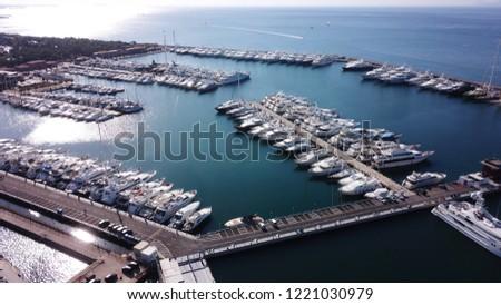 Aerial drone bird's eye view photo of luxury yachts docked in famous Marina of Flisvos, Faliro, Attica, Greece #1221030979