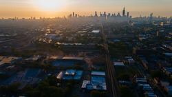 aerial drone footage of Chicago skyline during sunrise early morning with light fog rolling through the building architecture in the city. Gold hour in the metropolis is very beautiful