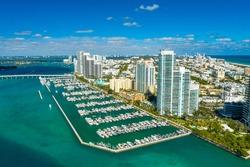 Aerial drone footage of Miami Beach marina in a wonderful day