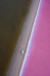 Aerial Drone footage of the pink salt Lake MacDonnell on the Eyre Peninsula outside of Point Sinclair in Penong, South Australia