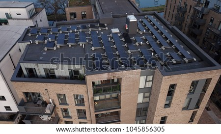 Aerial drone image of solar panels on the roof of a high rise building in London England.
