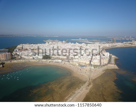 Aerial drone image of the famous beach city Cadiz in the South of Spain with the famous beach Playa La Caleta on a sunny day. #1157850640
