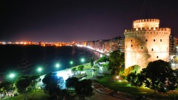 Aerial drone night view of illuminated downtown area of famous city of Thessaloniki or Salonica, North Greece