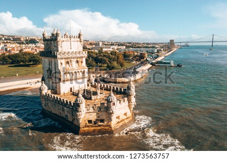 Aerial drone panorama photo of the Belem Tower. A medieval castle fortification on the Tagus river of Lisbon Portugal