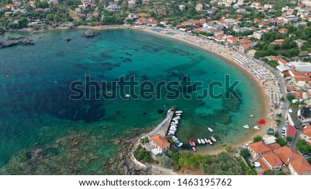 Aerial drone panoramic photo of iconic picturesque village and sandy beach of Stoupa in the heart of Messinian Mani, Peloponnese, Greece