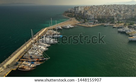 Aerial drone panoramic photo of iconic port of Marina Zeas or Pasalimani with yachts and sail boats docked and beautiful clouds at sunset, port of Piraeus, Attica, Greece #1448155907