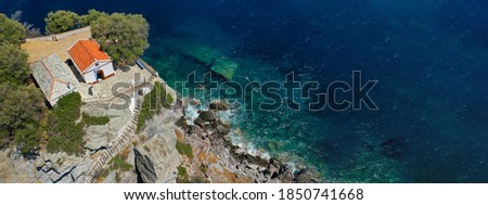 Aerial drone panoramic photo of picturesque chapel of Saint John built in famous cliff where Mamma Mia movie was filmed, Skopelos island, Sporades, Greece Stockfoto ©