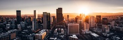 Aerial drone photo - City of Denver Colorado at sunset. Rocky Mountains on the horizon