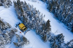 Aerial drone photo of a group of skiers and snowboarders in a snow cat in the Chic Choc Mountains of Quebec, Canada