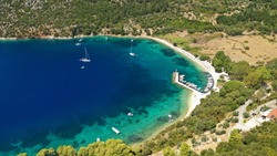 Aerial drone photo of bay and beach of Polis in Norther part of Ithaki or Ithaca island a safe sail boat anchorage, Ionian, Greece