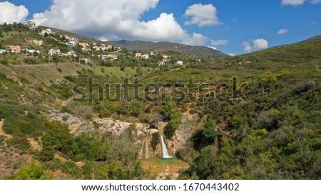 Aerial drone photo of beautiful waterfall of Valanaris in Drafi area near mount Penteli, Attica, Greece Foto stock ©