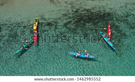 Aerial drone photo of colourful sport canoes operated by young athletes competing in Mediterranean bay with crystal clear turquoise sea