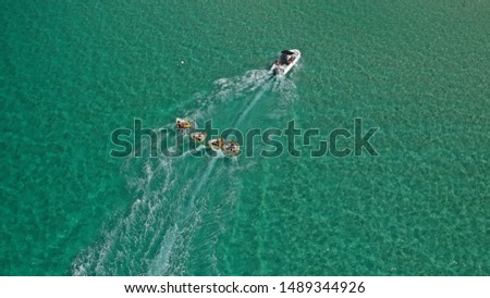 Aerial drone photo of extreme powerboat donut water-sports cruising in high speed in tropical turquoise bay #1489344926