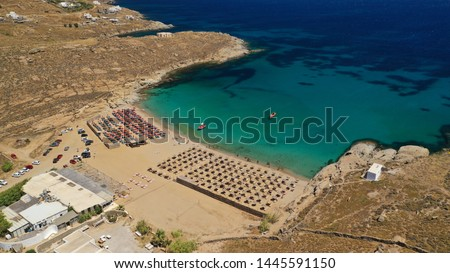 Aerial drone photo of famous organised with sun beds and umbrellas beach of Lia with emerald clear sandy sea shore, Mykonos island, Cyclades, Greece   Foto stock ©