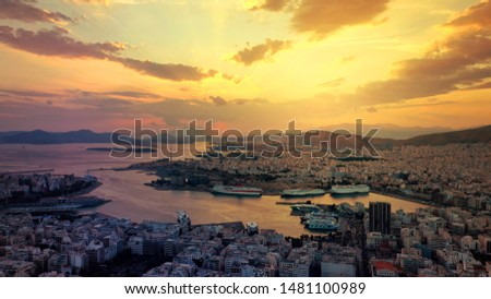 Aerial drone photo of famous port of Piraeus or Pireas one of the largest in Mediterranean sea where ships travel to popular Aegean destinations at sunset with beautiful golden colours, Attica, Greece