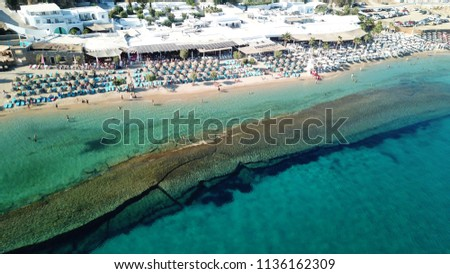 Aerial drone photo of famous turquoise and sapphire clear water beach of Paradise in popular island of Mykonos, Cyclades, Greece #1136162309
