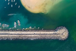 Aerial drone photo of fishing boats in port of Beris of chabahar, The fish boats moored in the harbor with docked yachts, Iran
