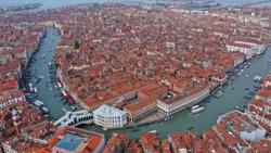 Aerial drone photo of iconic and unique Ponte Rialto or Rialto bridge crossing Grand Canal, Venice, Italy