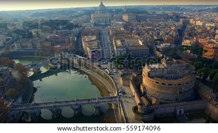 Shutterstock Aerial drone photo of iconic Castel Sant'Angelo next to river Tiber and city of Vatican at the background, Rome, Italy