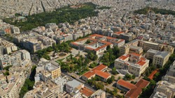 Aerial drone photo of iconic public neoclassic National Technical University of Athens and National Archaeological museum in the heart of Athens, Attica, Greece