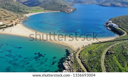 Fototapete Aerial drone photo of iconic two sided sandy tropical turquoise sea paradise beach of Kolones near Fykiada in island of Kythnos at spring, Cyclades, Greece