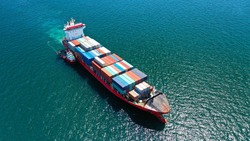 Aerial drone photo of industrial truck size container cargo ship cruising open ocean sea