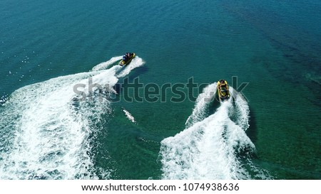 Aerial drone photo of Jet ski cruising in high speed in tropical clear waters