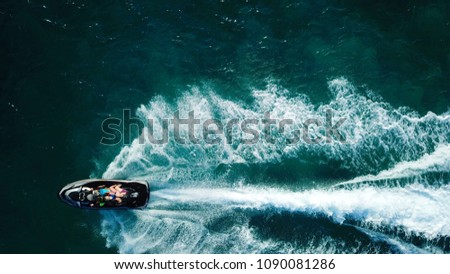 Aerial drone photo of Jet ski cruising in tropical turquoise clear waters