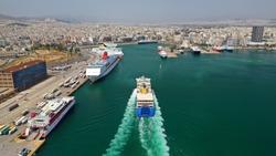 Aerial drone photo of passenger ferry reaching destination - busy port of Piraeus, Attica, Greece
