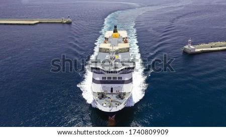 Aerial drone photo of passenger ferry reaching destination - busy port of Piraeus, Attica, Greece Foto stock ©