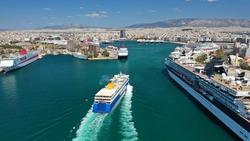 Aerial drone photo of passenger ferry reaching destination - busy port of Pireus, Attica, Greece