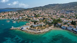 Aerial drone photo of picturesque chapel of Agios Mamas and three cannon monument in picturesque old seaside town of Spetses island, Saronic gulf, Greece