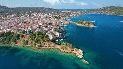 Aerial drone photo of picturesque small beach of Plakes in main village of Skiathos island, Sporades, Greece