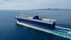 Aerial drone photo of Roll on Roll off vehicle carrier vessel (RO RO) cruising in Aegean deep blue sea, Greece