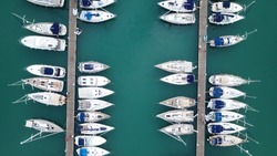 Aerial drone photo of sail boats docked in mediterranean destination port