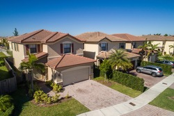 Aerial drone photo of single family homes in South Florida