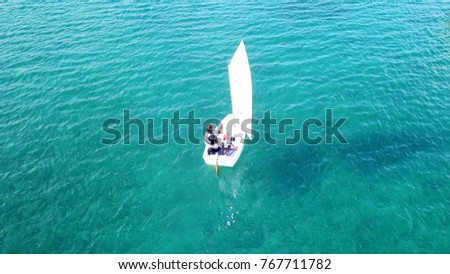 Aerial drone photo of small yachts operated by children in turquoise tropical waters