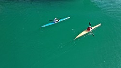 Aerial drone photo of sport canoe competing in tropical exotic green lake