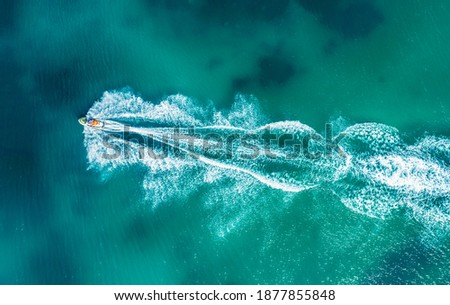 Aerial drone photo of stunt man performing extreme stunts with jet ski water craft over the Black sea at dusk Сток-фото ©