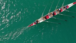 Aerial drone photo of team of Athletes rowing in sport canoe in tropical exotic lake