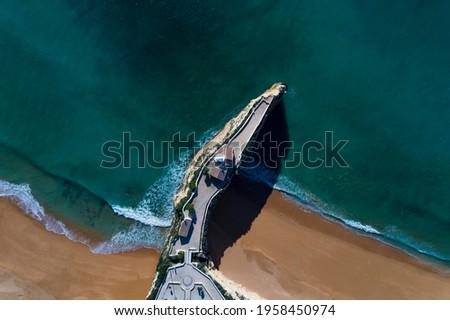 Aerial drone photo of the beautiful Praia da Senhora da Rocha (Senhora da Rocha Beach) with the white chapel on the roks, near Armacao de Pera, Algarve, Portugal Foto stock ©