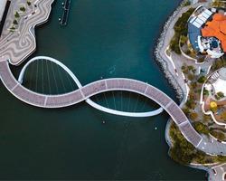 Aerial drone photo of the Elizabeth Quay Bridge in the middle of Perth, Western Australia.