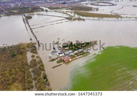 Aerial drone photo of the town of Allerton Bywater near Castleford in Leeds West Yorkshire showing the flooded fields and farm house from the River Aire during a large flood after a storm. Foto stock ©