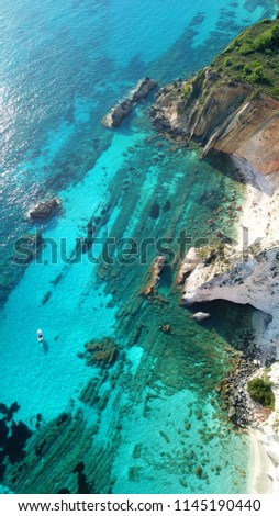 Aerial drone photo of tropical caribbean turquoise bay with large volcanic white cliffs and beautiful emerald sea #1145190440