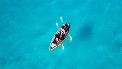 Aerial drone photo of 2 women canoeing in tropical Caribbean exotic destination with turquoise sea