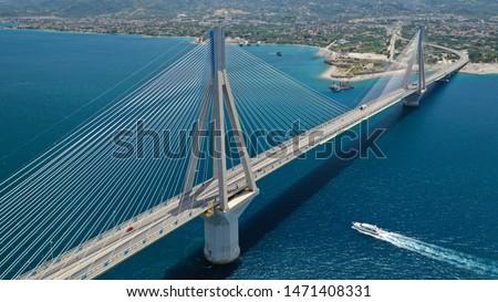 Aerial drone photo of world famous cable suspension bridge of Rio - Antirio Harilaos Trikoupis, crossing Corinthian Gulf, mainland Greece to Peloponnese, Patras #1471408331