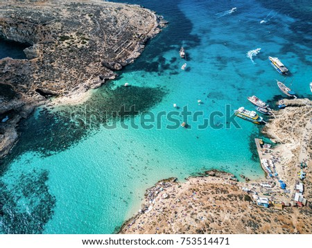 Aerial drone photo - The famous Blue Lagoon in the Mediterranean Sea.  Comino Island, Malta.