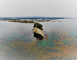 Aerial Drone Photograph of Mitsukejima (Mitsuke Island, Gunkanjima (Battleship Island)) in Noto Peninsula Quasi-National Park, Ishikawa Prefecture, Japan.